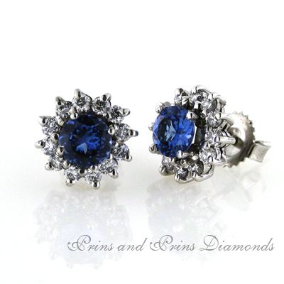 18ct white gold handcrafted tanzanite and diamond cluster earrings. 2x 0.50ct round brilliant cut tanzanites are set in this timeless design, surrounded by 12 diamonds. The total diamond weight is 0.50ct G/H VS/SI.  Order time for these earrings is 10 working days. We can custom create the perfect pair for you with the tanzanite sizes of your choice.