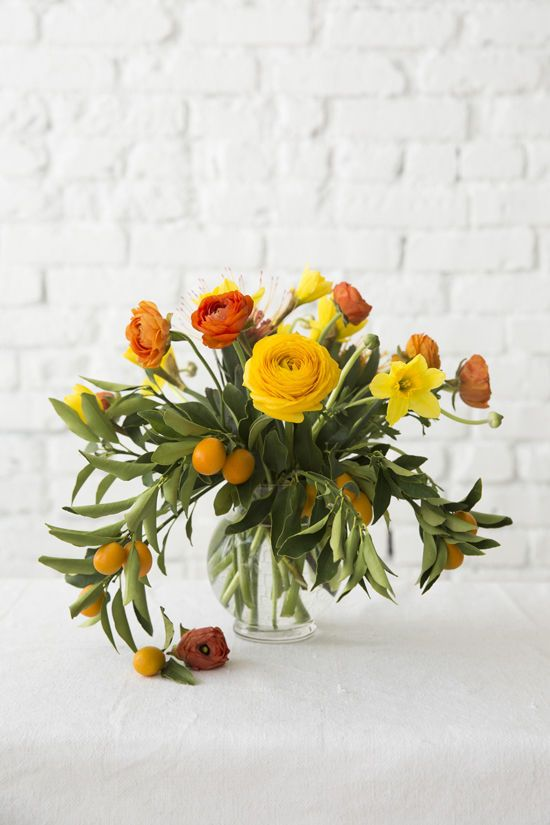 designlovefest The flowers used for this project (tulips, lilacs, ranunculus, daffodils, feverfew, wax flower, lavender, and kumquats)