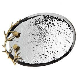 """Textured stainless steel tray with brass branch-inspired handles.Product:  Tray  Construction Material: Stainless steel and brass Color: Silver and gold   Features:Hammered accents    Two tone leaf design       Dimensions: 1.13"""" H x 13"""" W x 11.5"""" D      Cleaning and Care: Hand wash"""