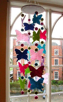 Would be sweet in pastels or bok n white music notes for wedding showerovely butterfly mobile tutorial from Bugs and Fishes