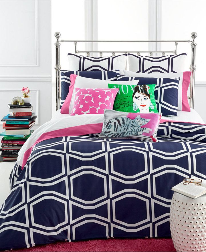 Decorate your bed with the chic and energetic look of kate spade new york's Bow Tile Navy duvet cover set, featuring a lively white bow tile pattern on a deep navy cotton ground.   Adding some bright throw pillows adds a bright, youthful and modern touch to the look.