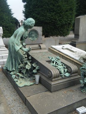 I love this....it's like the statue has been startled by something and dropped her flowers....Cimitero Monumentale Milan