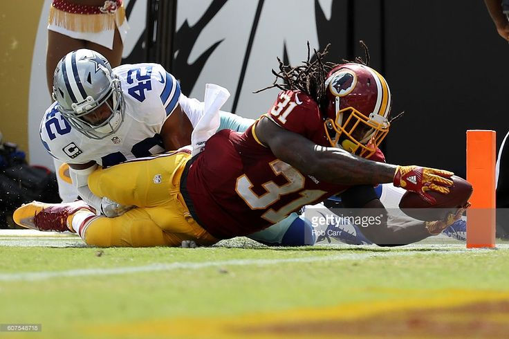 Running back Matt Jones #31 of the Washington Redskins scores a second quarter touchdown past strong safety Barry Church #42 of the Dallas Cowboys at FedExField on September 18, 2016 in Landover, Maryland.