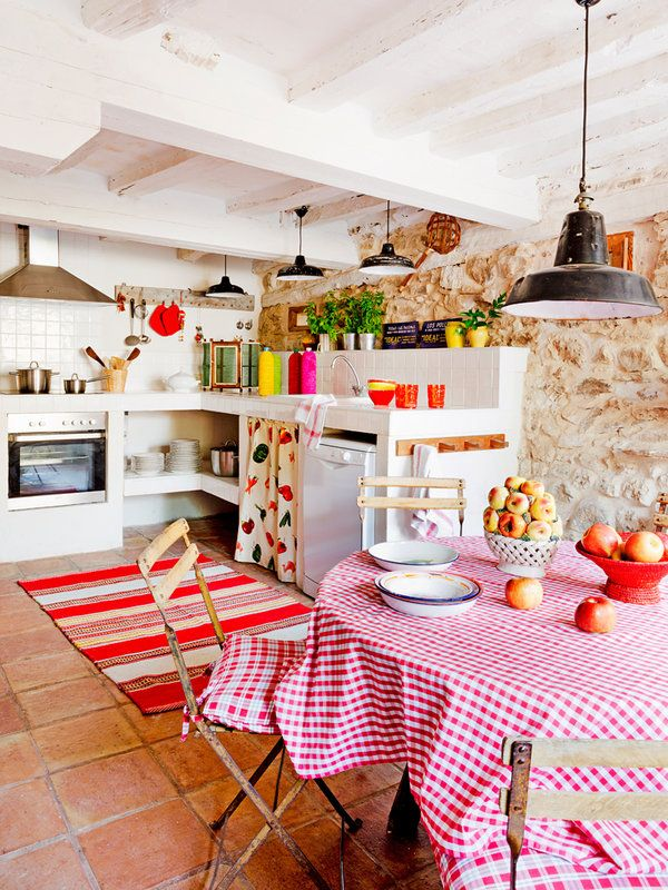 Spanish stone cottage evoking a warm rustic feel.  Cute print on sink skirt.  Love the open shelves for convenience.