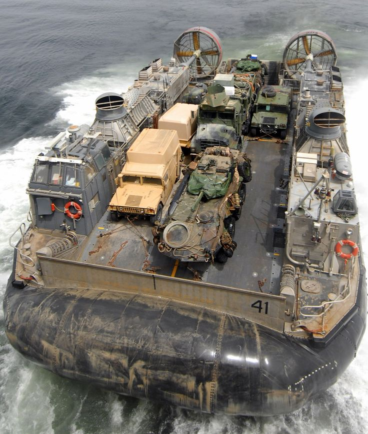 A landing craft air cushion (LCAC) leaves the well deck aboard USS Iwo Jima (LHD 7).
