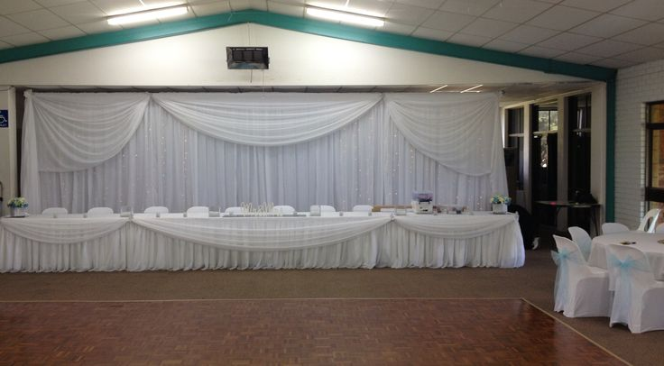 Bridal table and backdrop with curtain lights.