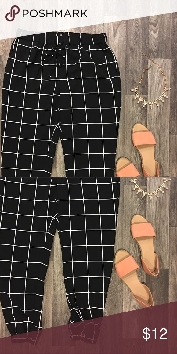 Grid design joggers Black and white grid design joggers tie at waist Pants