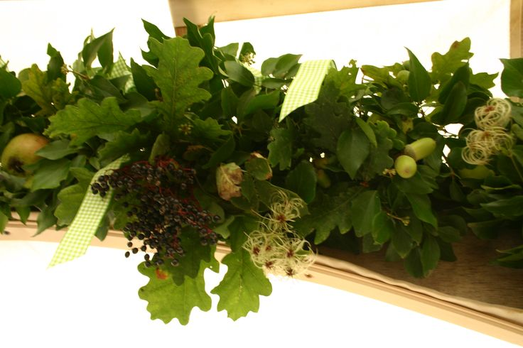 seasonal garland made with acorns, apples, oak leaves, elderberry, old man's beard - all made by www.commonfarmflowers.com, seasonal, english country flowers for the discerning flower lover