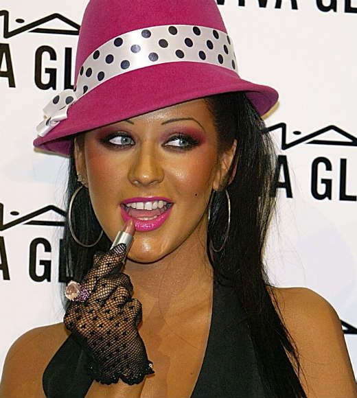 christina aguilerawith very tan skin pink lips and