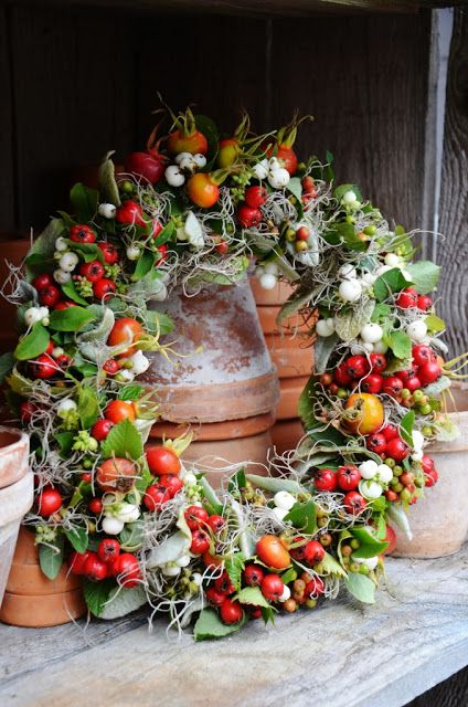 Wreaths this one looks like an edible one with cherry red and yellow tomatoes and fresh radishes,etc. If not then blame my eyesight for a good idea!