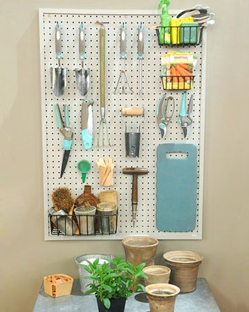 Organization for gardening tools.  Also use peg board in the kitchen, garage, office... organization in a small house!
