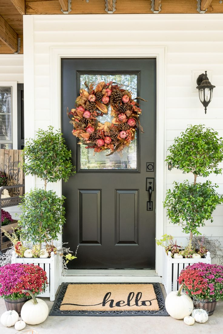 Create a cozy fall porch using plum and red mums with gold lanterns and floral toss pillows. This post is sponsored by Better Homes & Gardens at Walmart.