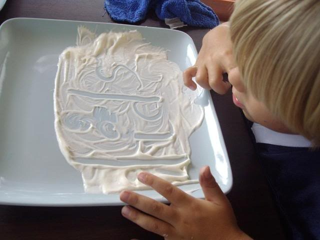 Pre-writing and fine motor skills and motivation for writing - writing in whipped cream (or chocolate syrup)