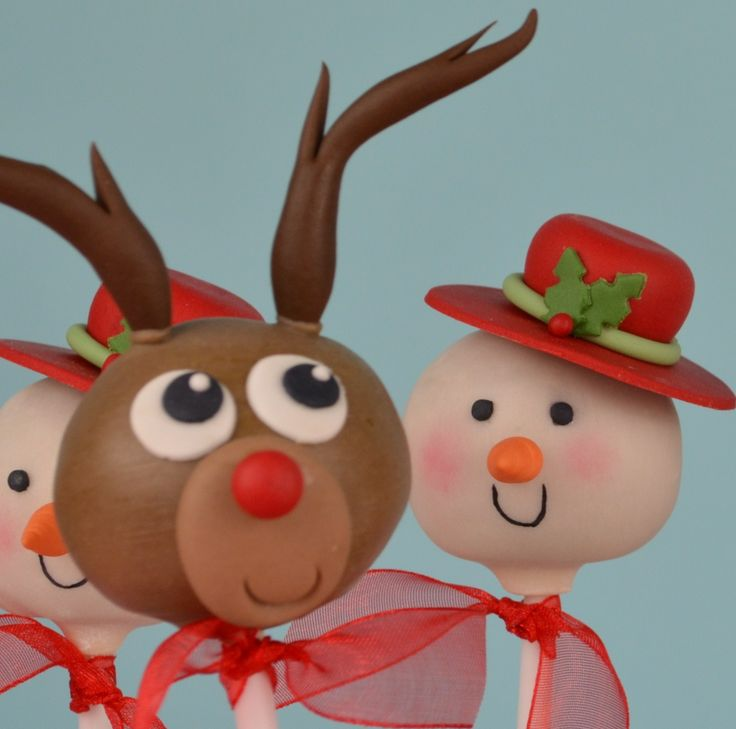 Reindeer and snowman cake-pops made for Step by Step Cake Decorating book DK publishing.