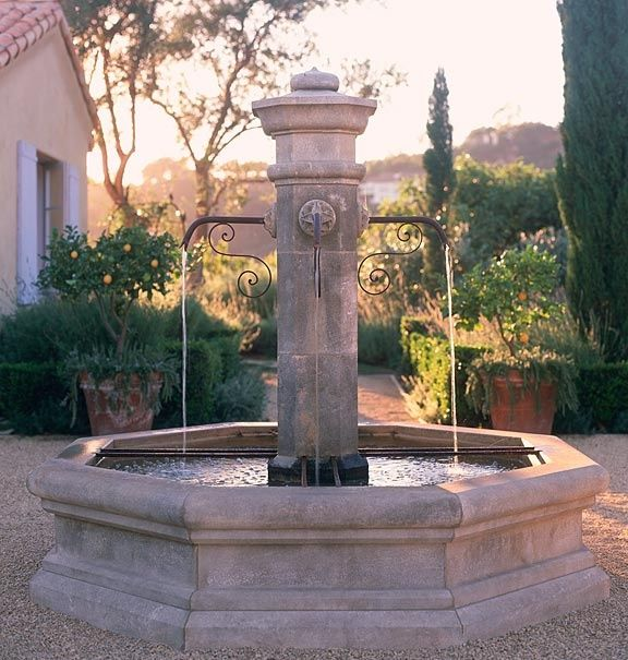 A fountain is essential in creating the ethereal Provencal garden. Exquisite Surfaces offers fountains, benches, tables, pots, pedestals, urns, and troughs for your garden or outdoor space