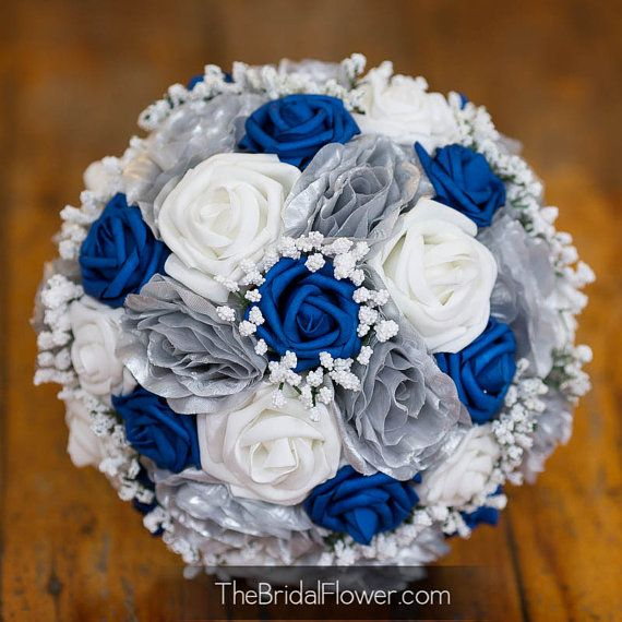 Royal blue and silver wedding bridal bouquet with baby's breath and soft touch and silk flowers in silver and horizon blue
