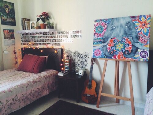 Room for the easel. Photos in a line. Shelf above bed.