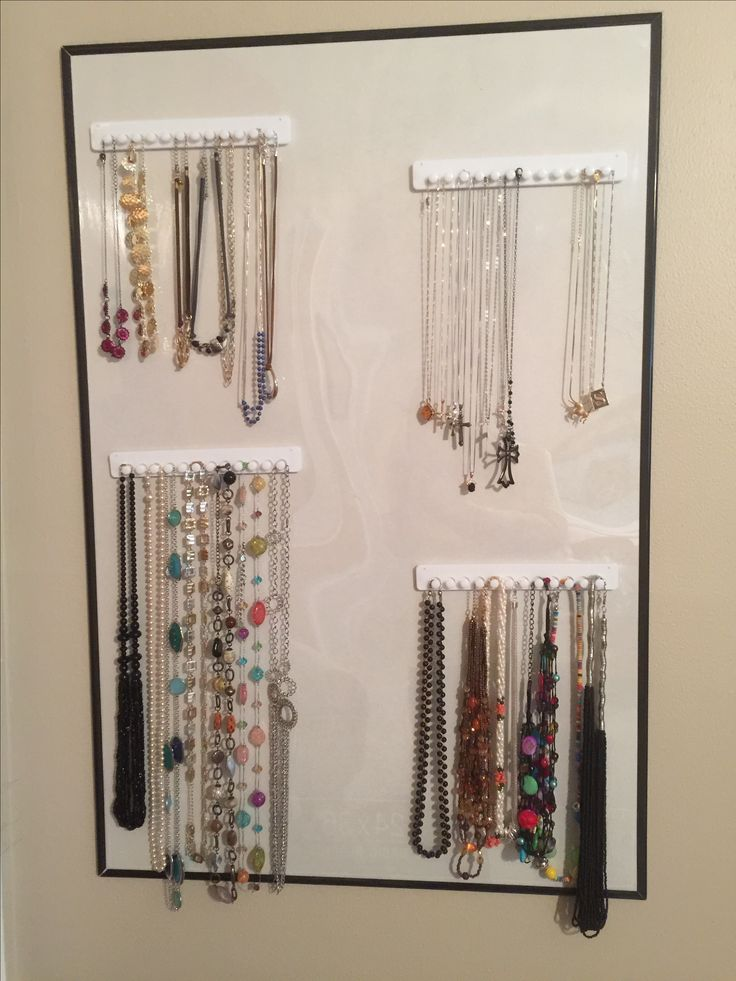 "I bought jewelry hook racks from Amazon..great adhesive, but one or two came off the painted wall occasionally..so bought cheap poster frame and stuck to it..if still come off there are screw holes at each end of racks..will screw into the acrylic  ""glass"" of the frame..lice it, behind bedroom door can find necklaces so much faster!, not tangled..."