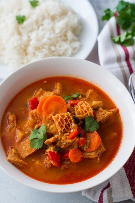Dominican Style Tripe Stew (Mondongo) - A warm comforting stew made with beef tripe, onion, garlic, peppers, carrots, potatoes, tomato sauce, and cilantro.