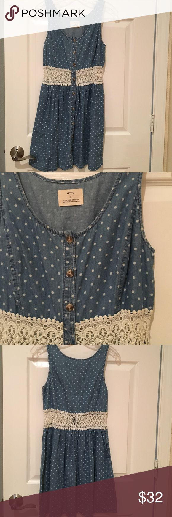 Dress Denim polka dot button up dress with crochet cut out. Size small once once to a country concert looks adorable with cow boy boots! Dresses