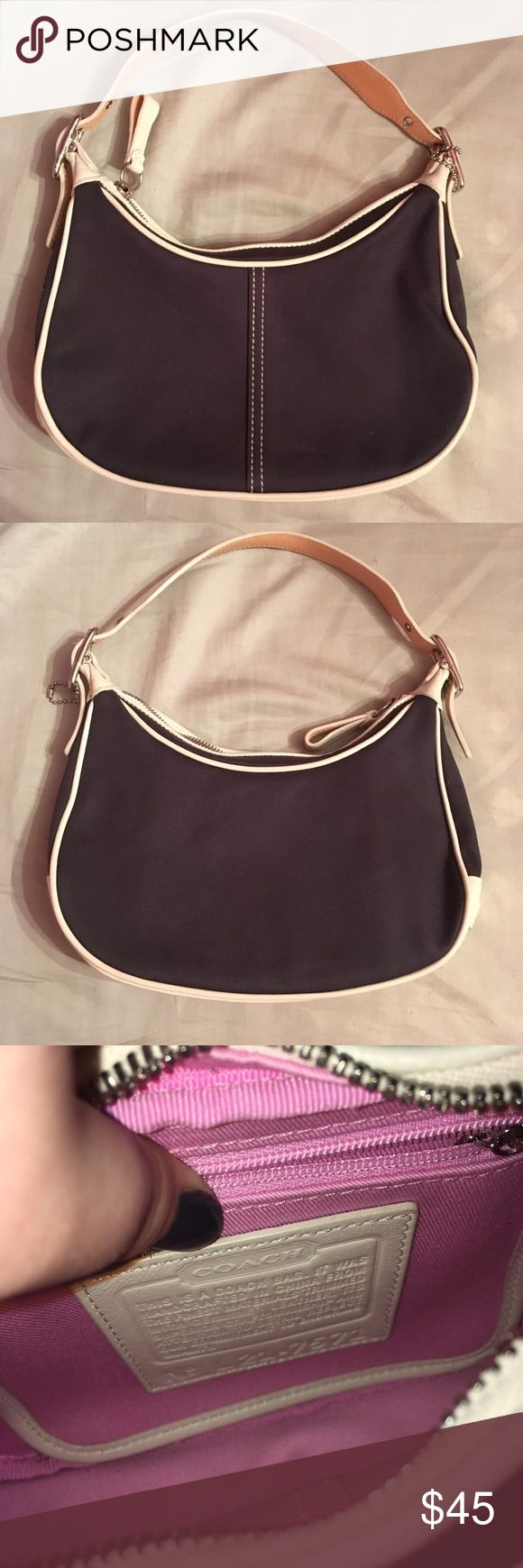 """Coach Hobo Bag Looks Brand New I've only used it like once, so it is just like new almost. It looks great, and I can't find anything wrong with it. I don't see any stains or flaws. One of the pictures has a part on the outside of the purse that says """"Coach Leatherware."""" The inside of the purse is pink. The outside is navy blue and white. Coach Bags Hobos"""