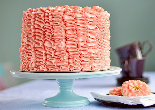 Coral colored ruffle cake