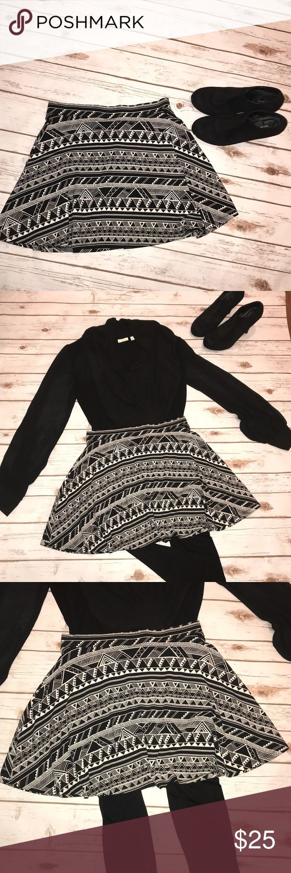 VS Pink Black & White Aztec Print Skirt Super cute, looks new! Pictures say it all - super soft skirt that you can wear with leggings in the winter or with a simple black top in the summer! Stretchy material. PINK Victoria's Secret Skirts Mini