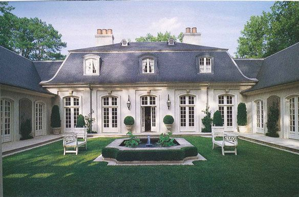 Formal french country house facade with courtyard ad for French country courtyard