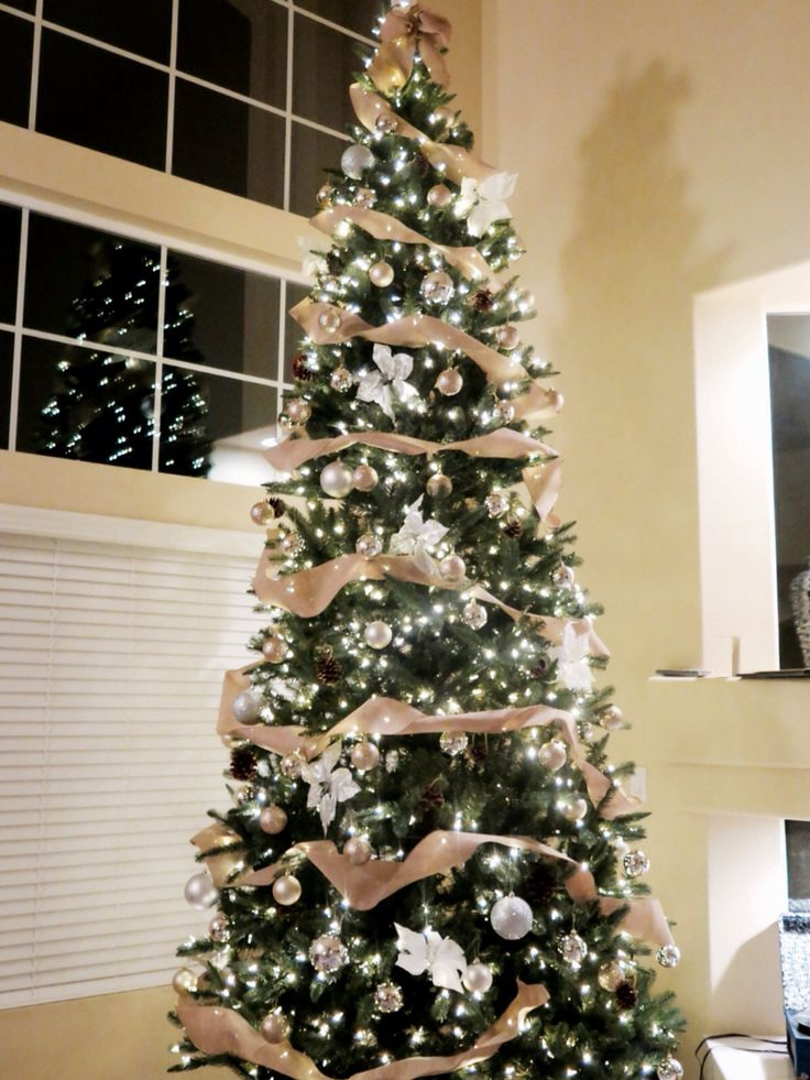 12 ft Rustic glam Christmas tree. 1 spool Burlap ribbon + rose gold and silver ornaments + white poinsettia clip on ornaments + pine cones
