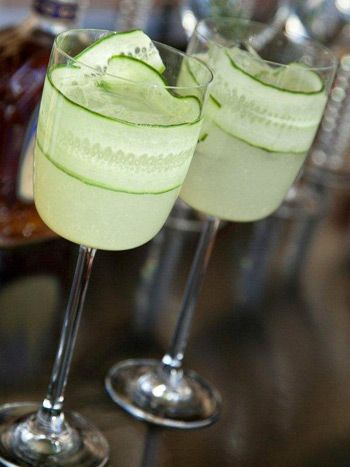 A fun way to dress up a cocktail: line the inside of the glass with a garnish, like this cucumber gimlet from Design Cuisine. Photo: ImageLink Photography