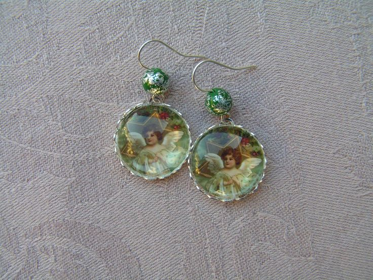 Angelic Salutation  --    Beautiful 20 mm glass lens earrings completed with small, (silver) metal leaves decorated polymer clay beads.
