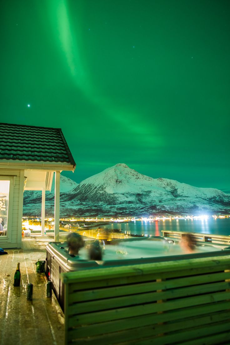 Northern Lights from a hot tub.    Tromvik Lodge, 40 min drive from Tromso on the northern coast of Norway