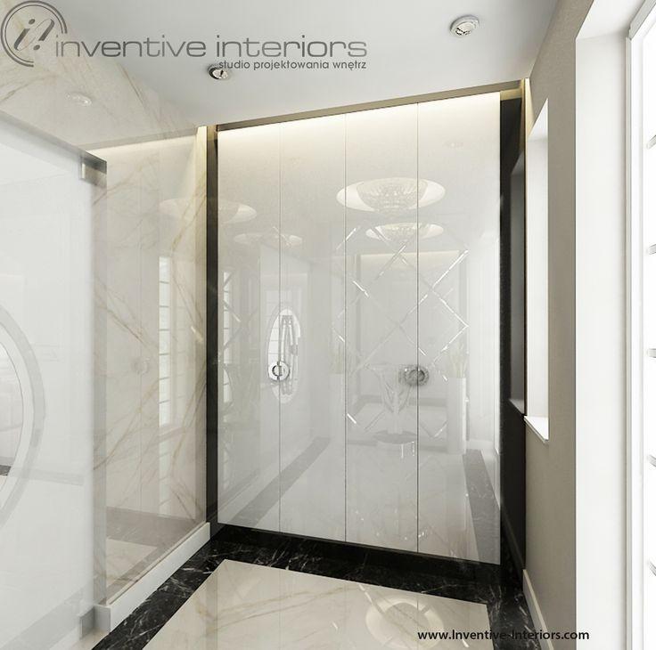 Projekt wiatrołapu Inventive Interiors - luksusowy wiatrołap w bieli i beżu z akcentem czerni