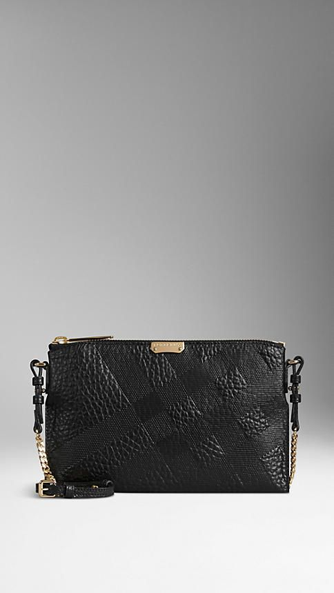 Black Embossed Check Leather Clutch Bag from Burberry  - Clutch bag in check-embossed signature grain leather.  Zip closure, detachable leather and metal chain strap.  Discover the women's bags collection at Burberry.com