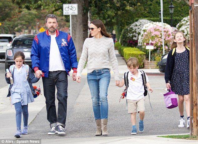 Family affair: Ben Affleck and Jennifer Garner, both 45, held hands with Violet, 12, Serap...