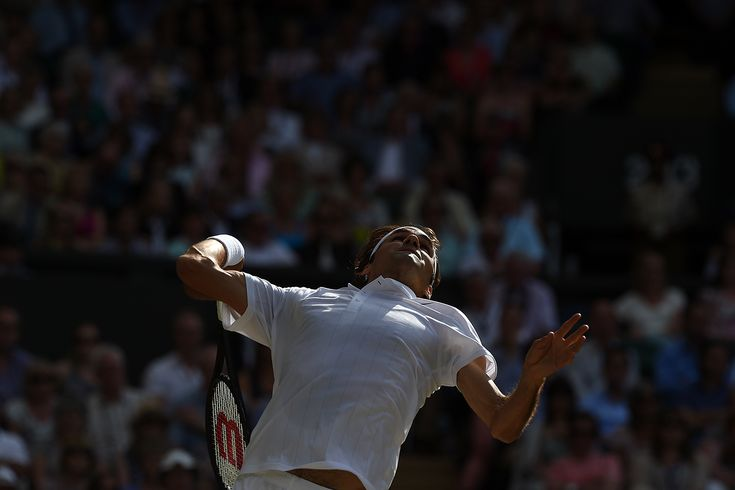 Roger Federer prepares to serve on Centre Court - Jon Buckle/AELTC ~ Wimbledon 2014