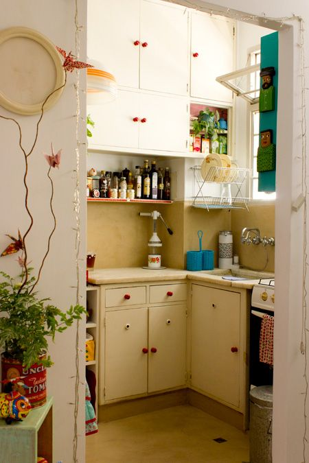 Super tiny kitchen Let the cabinets reach the ceiling Add mid-air drainage  Make the sink small