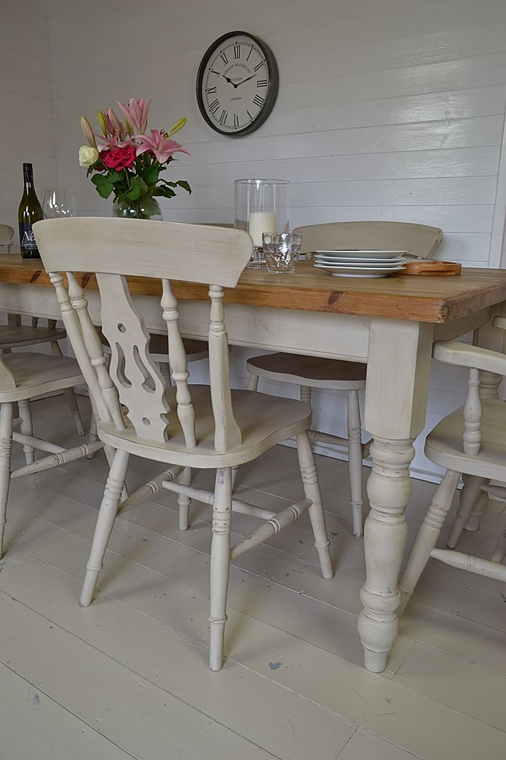 Large dining tables with turned legs and a solid wood tabletop are a key piece of furniture in creating the farmhouse feel in a large open-plan kitchen. This set has been painted to match, and lightly distressed to give a rustic country cottage feel.
