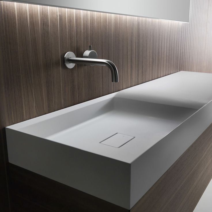 Pic On A celebration of purity through soft finishes and linear forms the Falper Pure basin and integrated cabinet features a unique extended functional top that