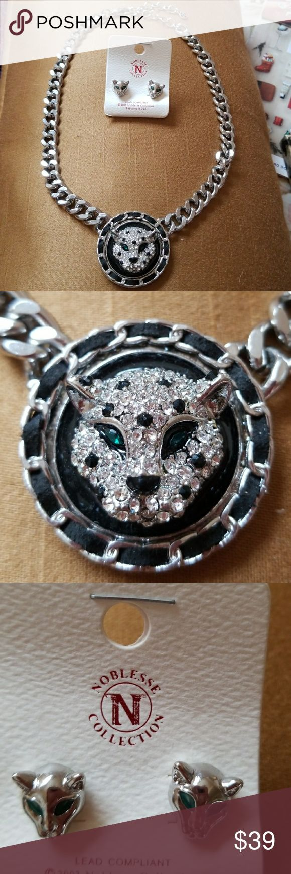 NWOT Panther Necklace and Earring Set Worn by Rhianna, this panther necklace and earring set was also featured on the TV show Empire. Panther head is woven with a piece of suede and has green stone eyes. Great for holiday gift giving. Comes with free gift box. LA Designs Jewelry