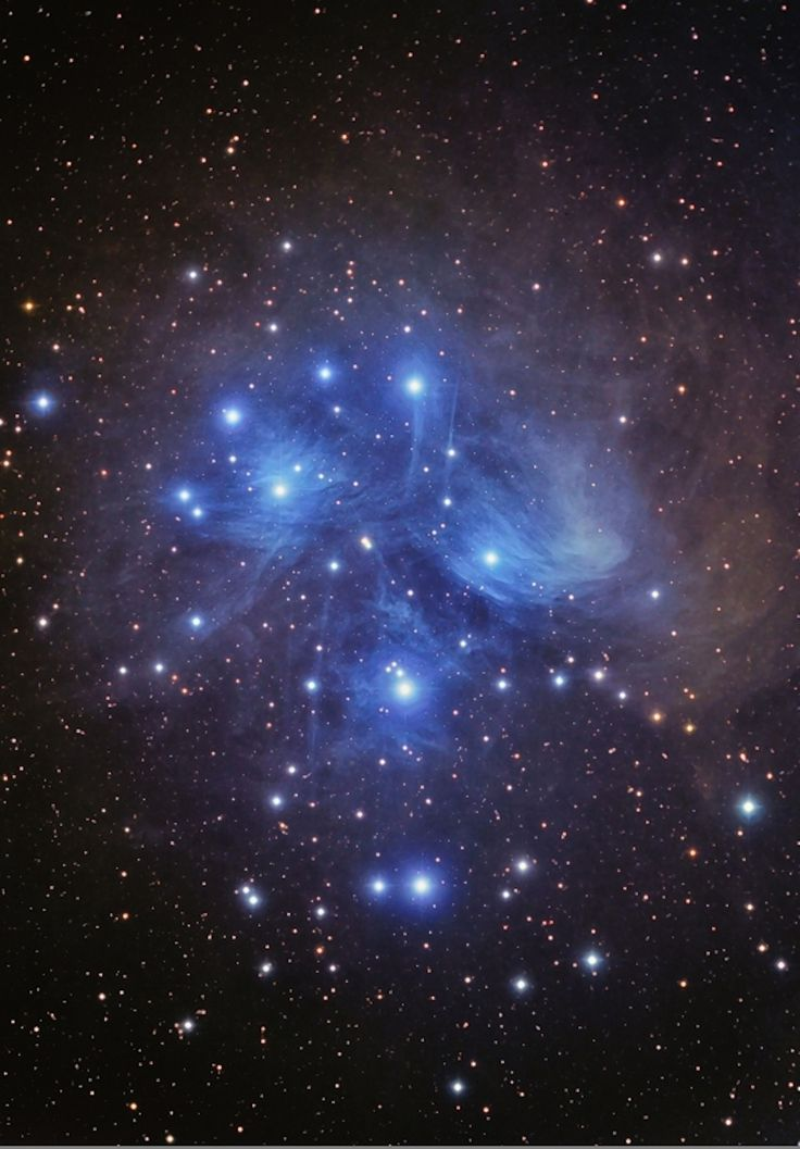 The Pleiades star cluster (M45) is a group of 800 stars formed about 100 million years ago. The cluster is located 410 light-years away from Earth in the constellation Taurus.