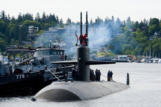 USS Bremerton will return to namesake city to be inactivated.Los Angeles-class fast attack submarine will arrive fall 2017 at Puget Sound Naval Shipyard & Intermediate Maintenance Facility.It'll be moored until employees become available to perform work.Bremerton facility,busy with several other jobs,only place in country where submarines recycled.Bremerton oldest commissioned submarine in Navy,launched 36 years ago,July 22,1978,Groton,Conn. commissioned March 28,1981.