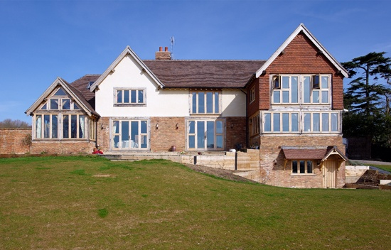 The three storey house has been partially clad with clay tiles to fit in with the local Kent style, and cream render on the first floor. Extensive glazing means the house is flooded with light internally.