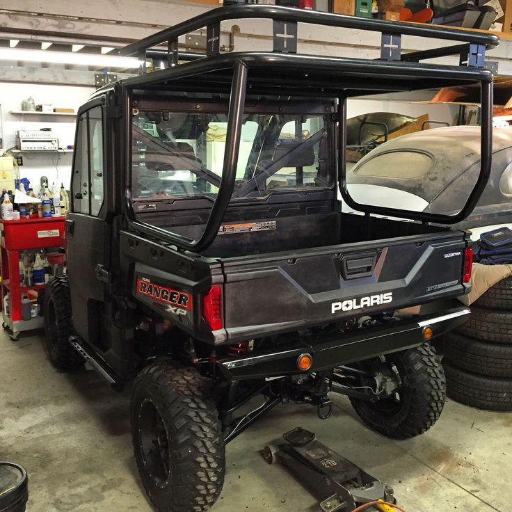ROLL CAGE, ROOF AND SAFARI RACK INSTALLED ON A POLARIS