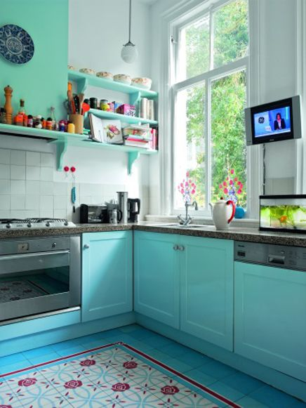 I love the color of this kitchen.. I want a Retro kitchen with black & white floors