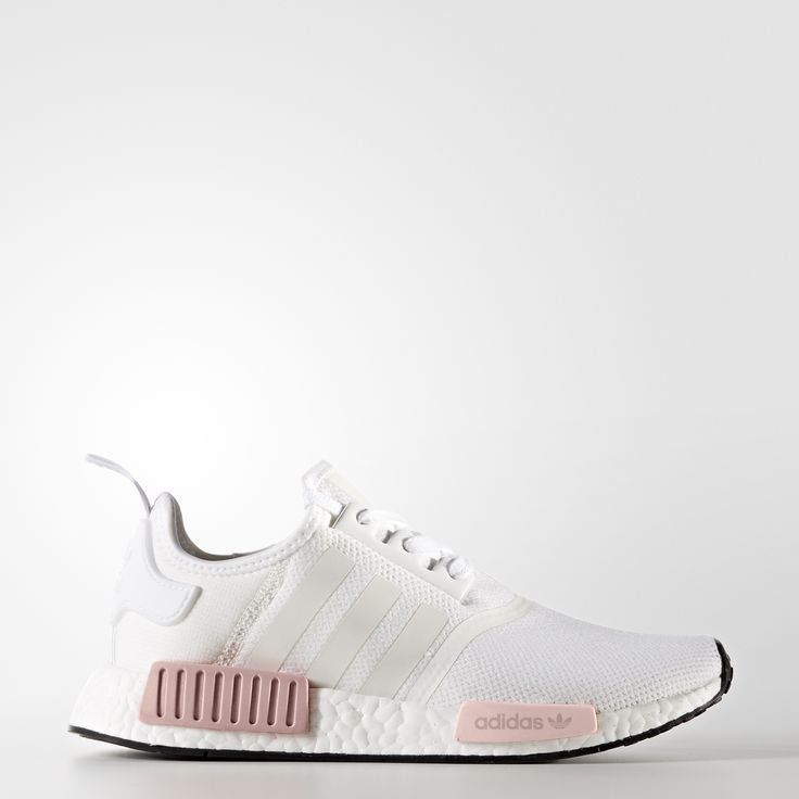 A breakthrough in adidas Originals design, these women's shoes offer a full length boost™ midsole for continuous energy. A reflective tongue tab and 3-Stripes adorn the stretch-mesh upper for flashy details. Molded EVA plugs complete the NMD aesthetic.