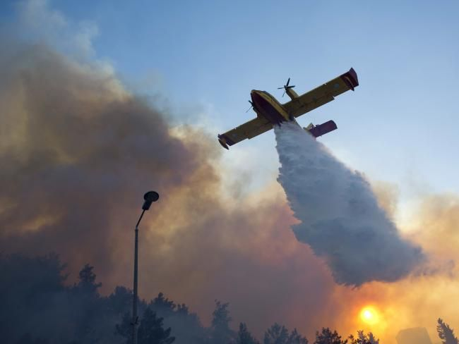 A firefighting plane from Greece fights a wildfire in Haifa, Israel. Picture: AP Photo/Ariel Schalit