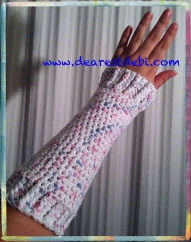 Crochet Wrist Warmers by DearestDebiThis crochet wrist warmers pattern is based off of my arm warmers pattern I posted the other day. I\\\'ve seen a few reqests in forums for this style of wrist/arm warmer, at least that\\\'s what I think people are asking for.Again I used cotton for this ...