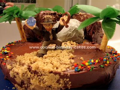 Indiana Jones Cake: This Indiana Jones cake was made from one box of chocolate cake mix, baked in a 9 circle, 1 mini loaf pan and 1 cupcake, according to package directions.