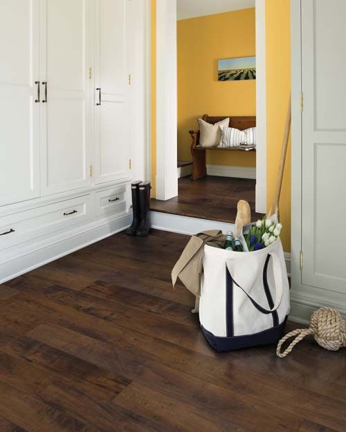 With Dark Pergo Max Premier Chateau Maple Flooring, This Yellow Room Is  Both Playful And